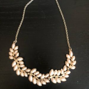 Mid length. Silver chain light pink leaves